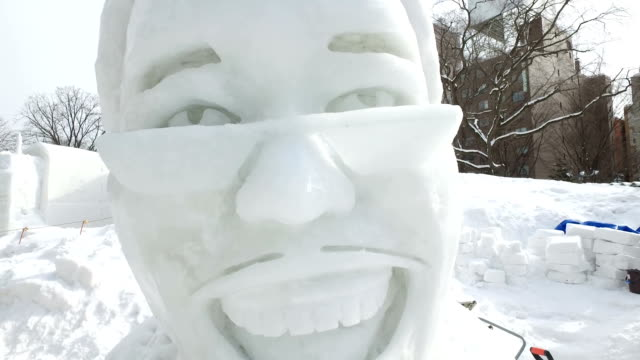 """a snow statue of pikotaro the japanese comedian who went viral with his song """"ppap"""" at the 68th sapporo snow festival in sapporo on february 6 japan - schneefestival stock-videos und b-roll-filmmaterial"""