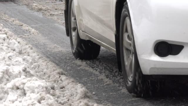 Snow storm: cars splashing slush ice in urban avenue: - Toronto, Canada