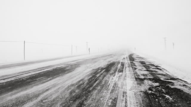 snow storm on the road - kars stock videos & royalty-free footage