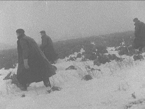 snow thaw continues; 9.00pm england: birmingham: birmingham city stadium: ext / snow various of men using shovels to clear snow from pitch gil... - loading stock videos & royalty-free footage