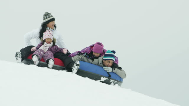 snow tubing - tubing stock videos and b-roll footage