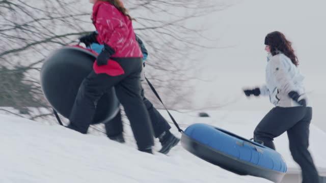 snow tubing - sliding stock videos & royalty-free footage