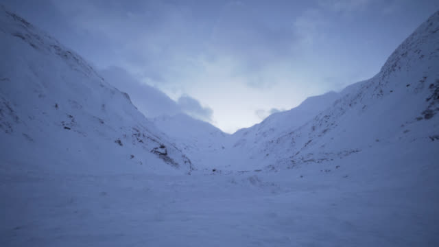 Snow valley - tracking shot