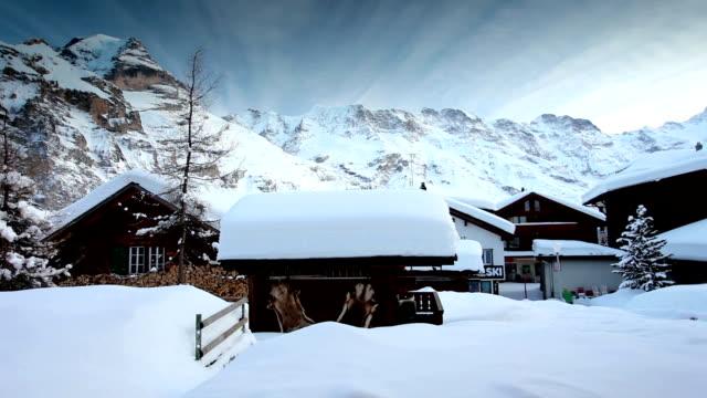 snow village under jungfrau - village stock videos & royalty-free footage