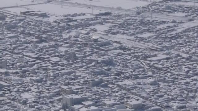 aerial, snow white urban area, akita, japan - 秋田県点の映像素材/bロール