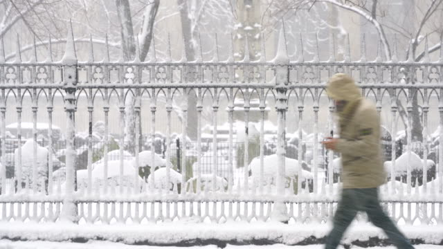 snow wraps up the trinity church cemetery fence during the snowstorm at lower manhattan on feb. 09 2017. - cemetery stock videos & royalty-free footage