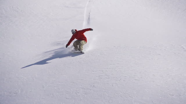 snowboarder does powder turn - snowboard stock videos and b-roll footage