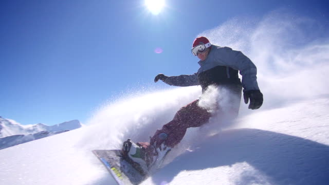 snowboarder does powder turn - snowboarding stock videos & royalty-free footage
