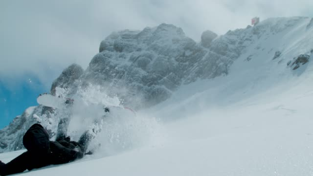 slo mo snowboarder falling on the slope - winter sport stock videos & royalty-free footage