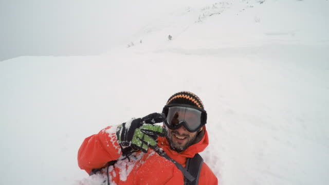 pov snowboarder falling while skiing in a powder snow - goggles sportswear stock videos and b-roll footage