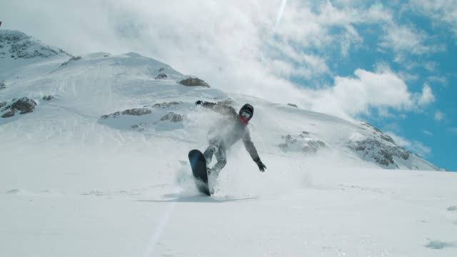 slo mo snowboarder falls after performing a trick - falling stock videos & royalty-free footage