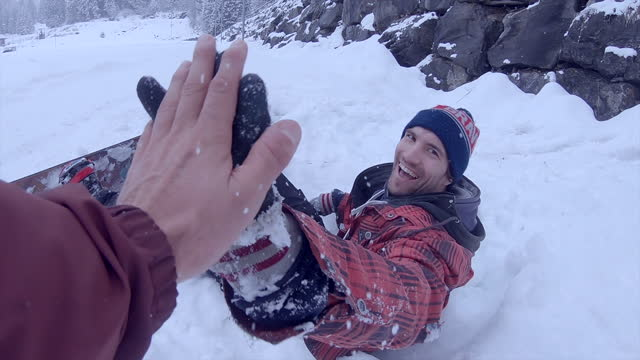snowboarder gives a high five and smile while snowboarding. - slow motion - ski resort stock videos & royalty-free footage