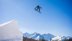 Snowboarder jumping in a snowpark