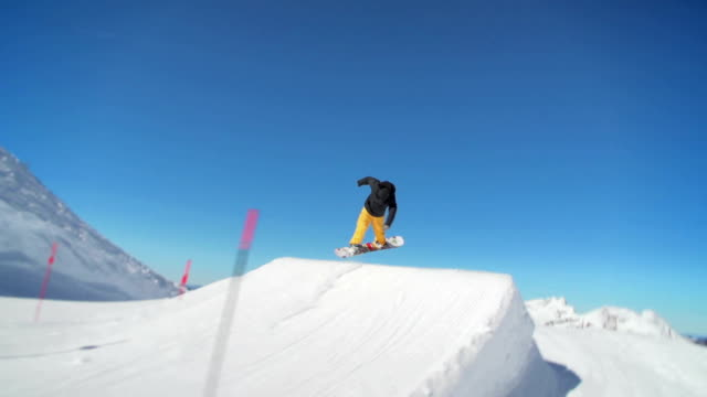Snowboarder jumps in a snowpark