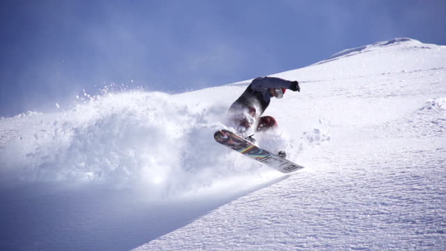 snowboarder jumps in freshly fallen snow - snowboard stock videos and b-roll footage