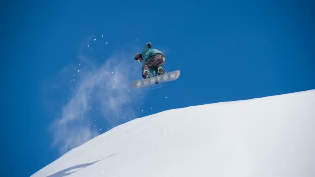 snowboarder jumps on fresh snow - snowboard video stock e b–roll
