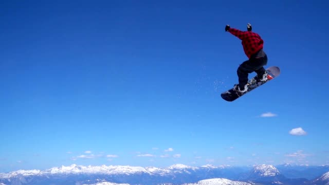 slo mo snowboarder making a 360 jump - snowboard stock videos and b-roll footage