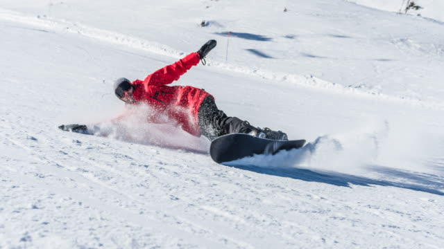 snowboarder making a turn on ski slope - skiing and snowboarding stock videos and b-roll footage