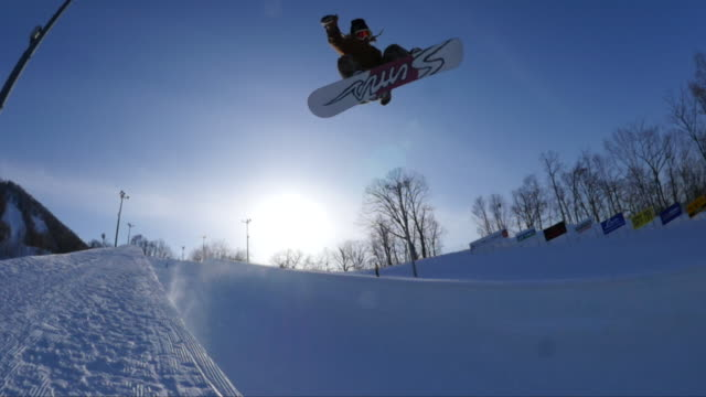 snowboarder on a bank of japan's largest halfpipe at ban.k hokkaido - winter sport stock videos and b-roll footage