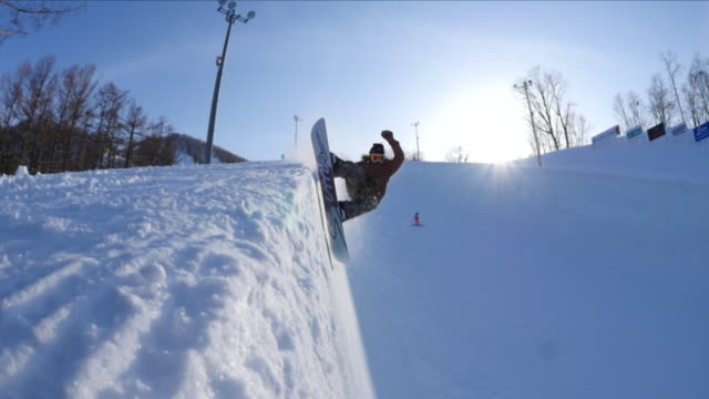 snowboarder on a bank of japan's largest halfpipe at ban.k hokkaido - half pipe stock videos & royalty-free footage