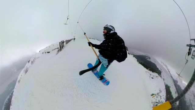 snowboarder on a ropeway riding to the top of the mountain - ski holiday stock videos & royalty-free footage