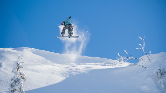 snowboarder performing a stunt - stunt stock videos & royalty-free footage