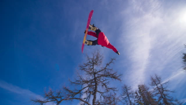 snowboarder performing a trick on the slopes - snowboarding stock videos & royalty-free footage