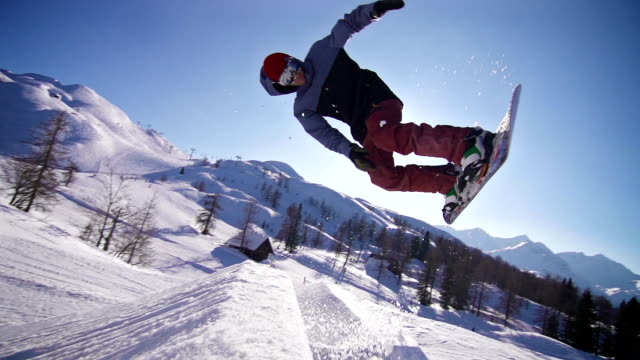 snowboarder performing a trick - snowboard stock videos & royalty-free footage