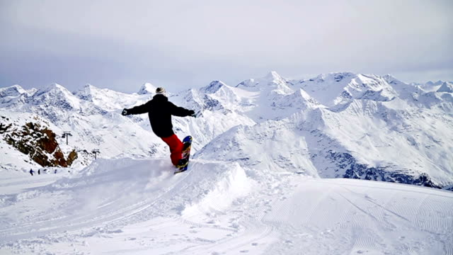 snowboarder performs a trick in snowpark - exhilaration stock videos and b-roll footage