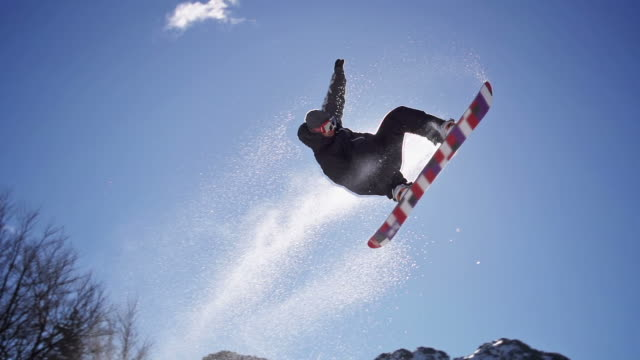 snowboarder jumps - snowboard stock-videos und b-roll-filmmaterial