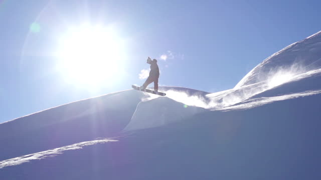 Snowboarder performs a trick