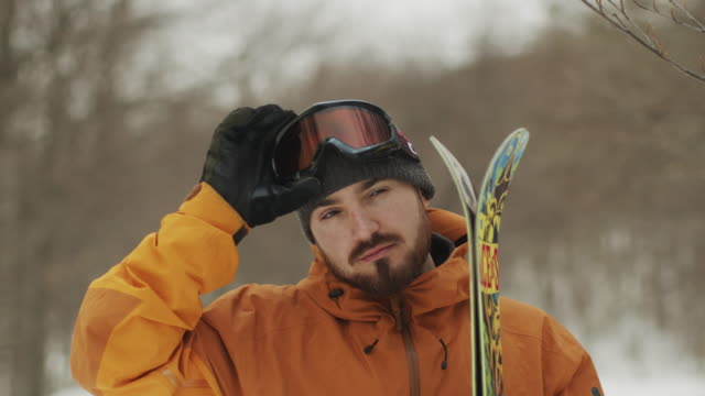 snowboarder putting his goggles  stock video - snowboarding stock videos & royalty-free footage
