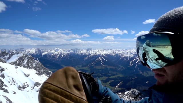 slo mo snowboarder putting on his ski goggles - ski goggles stock videos & royalty-free footage