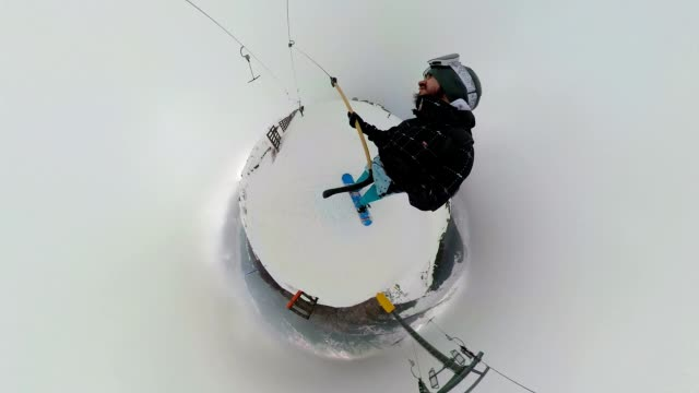 snowboarder riding on a ropeway at the mountain while holding a monopod - ski holiday stock videos & royalty-free footage