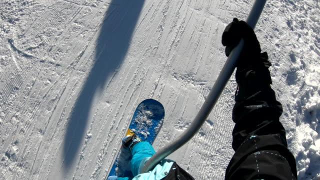 pov of snowboarder riding ski lift - ski lift stock videos & royalty-free footage