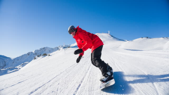 snowboarder rushing down an empty ski slope - skiing and snowboarding stock videos and b-roll footage