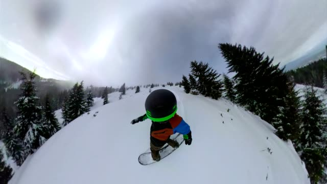 snowboarder shredding  fresh powder snow on a descent - crash helmet stock videos and b-roll footage