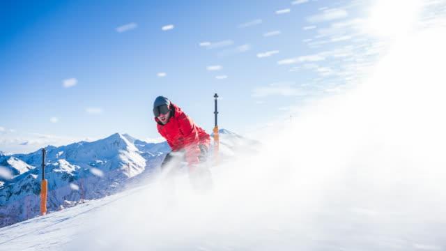 snowboarder spraying snow into camera - snowboarding stock videos & royalty-free footage