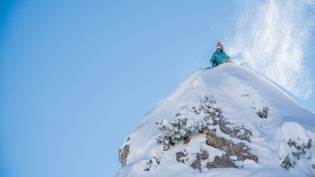 snowboarder standing on top of snowcapped mountain - snowboard stock videos and b-roll footage
