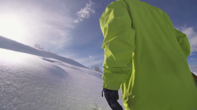 snowboarder walking in freshly fallen snow - mgost stock videos and b-roll footage