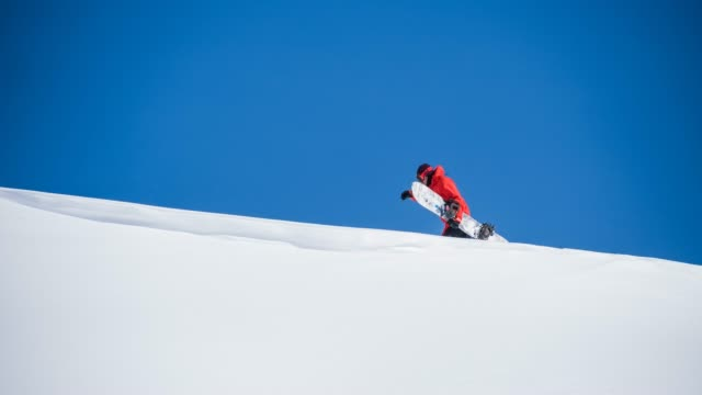 snowboarder walking in snowy backcountry landscape - skiing and snowboarding stock videos and b-roll footage