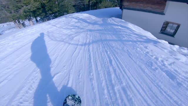 snowboarding at a ski resort man riding shadow snow covered mountain. - slow motion - ski resort stock videos & royalty-free footage