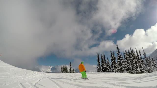 stockvideo's en b-roll-footage met snowboarden volg cam - following moving activity