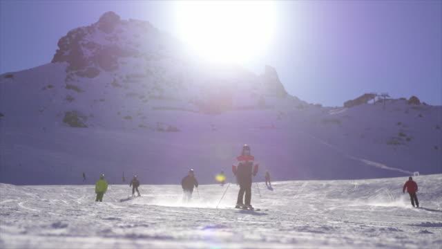 snowboarding on snow mountains in winter at a ski resort. - リゾート地点の映像素材/bロール
