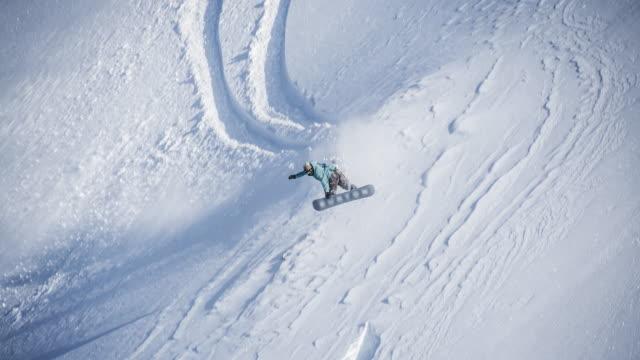 snowboarding powder jump - powder snow stock videos & royalty-free footage
