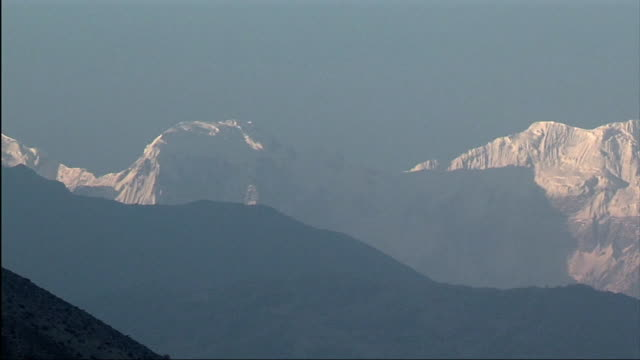 ws pan me snowcapped annapurna range / mustang, nepal - annapurna range stock videos and b-roll footage