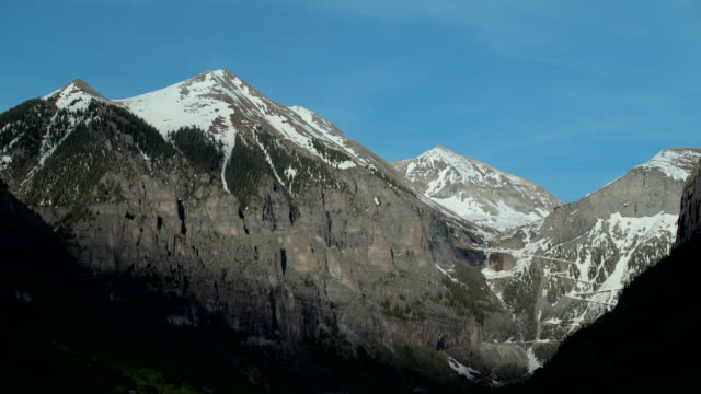 snowcapped mountain valley dusk - colorado stock videos & royalty-free footage
