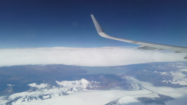 snowcapped mountains and sea of clouds view from airplane / antarctica - south pole stock videos & royalty-free footage