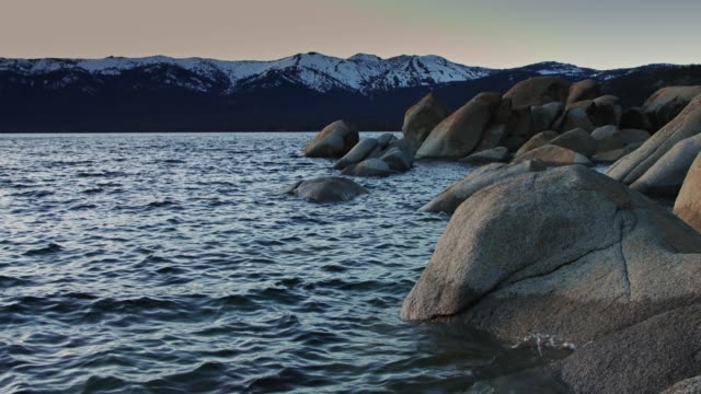 snowcapped mountains over lake tahoe at twilight - state park stock videos & royalty-free footage