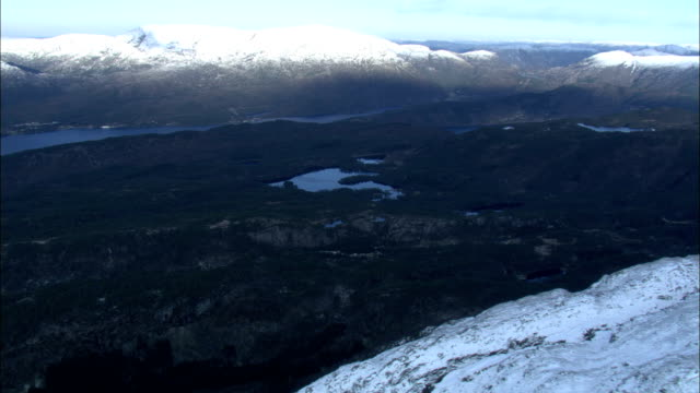 snow-capped mountains surround the norwegian sea. available in hd. - norwegian sea stock videos & royalty-free footage